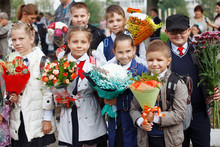 A Group Of Schoolgirls With Flowers.