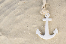 A White Anchor In The Sand On The Beach