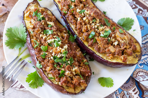 Classic baked eggplant close-up with meat, walnut and vegetables. Traditional middle eastern or arab dish.