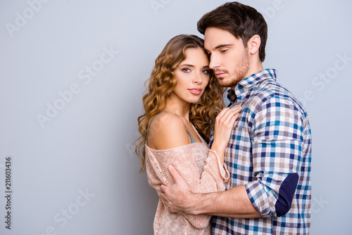 Photo Portrait with copy space empty place of lovely sensual couple hugging, sexy girl