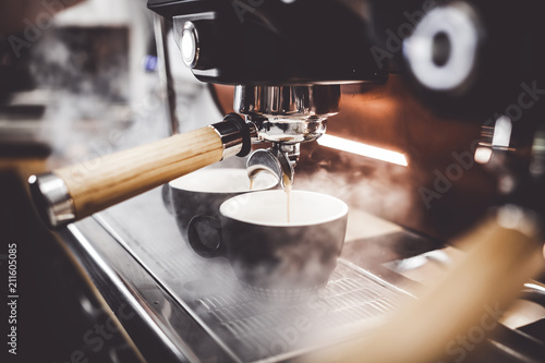 Fotografiet Espresso poruing from coffee machine at cafe