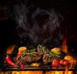 Leinwandbild Motiv Beef steaks on the grill with flames
