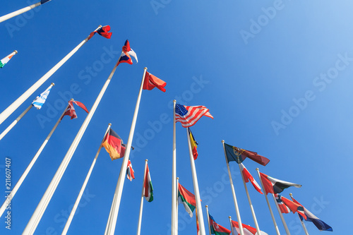 Valokuva  Bottom view of a rows of flags of different countries of the world, flutters in