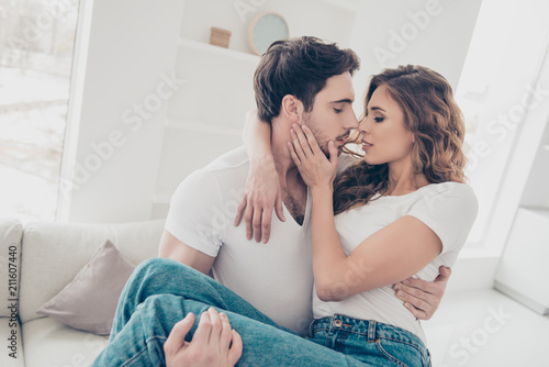 Love story true feelings harmony idyllic inspiration concept. Portrait of lovely romantic couple in white t-shirts enjoying time together indoor