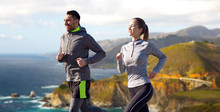 Fitness, Sport, People And Healthy Lifestyle Concept - Happy Couple Running Over Bixby Creek Bridge On Big Sur Coast Of California Background