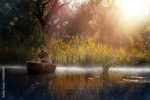 Foto op Aluminium Ontspanning Fishing. Man fishing on a lake on boat