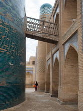 Woman Walking On Brick Oriental Street