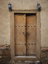 Aged Wooden Door In Metal Rivets