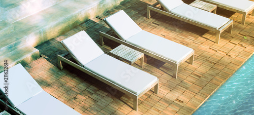 Spoed Foto op Canvas Trappen Blank white loungers mockup near swimming pool near luxury hotel. Lounge mock up for summer holidays. Sunbed for sunbathing in the inn template.
