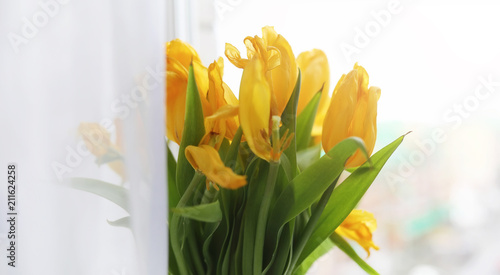 Wall Murals Tulip A bouquet of red tulips in a vase on the windowsill. A gift for
