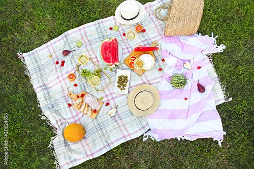 Keuken foto achterwand Picknick Picnic with white wine on green grass