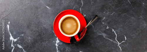 Deurstickers Cafe Coffee in a red cup on the Dark Marble Background.Cappuccino or latte .Copy space for Text. Top View. Flat Lay. Banner