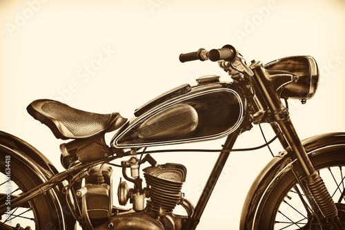 Sepia toned image of a vintage motorcycle