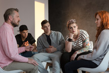 Rebellious Teenagers Listening To A Ginger Girl During A Meeting Of A Support Group