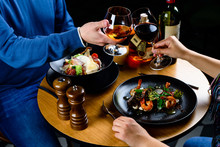 Unidentified Couple Enjoying Time During Romantic Dinner In The