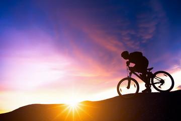 Fototapeta Extreme mountain bike sport athlete man riding outdoors lifestyle trail.