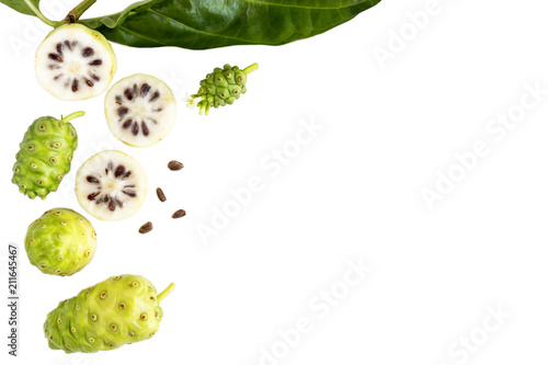 Montage in der Fensternische Fruchte Noni fruit or Morinda Citrifolia and noni slice with seed and green leaves of the noni isolated on white blackground with copy space for text. Top view