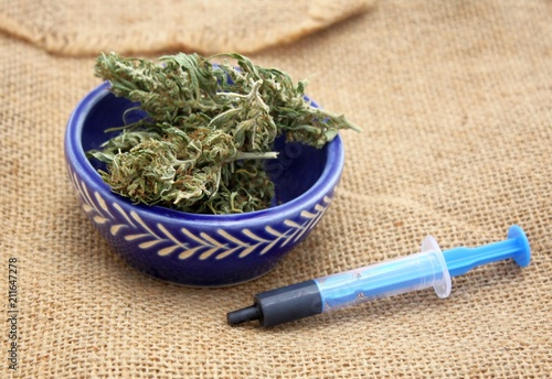 Fotografie, Tablou  Hash oil phoenix tears medicine in little syringe with dry marijuana buds