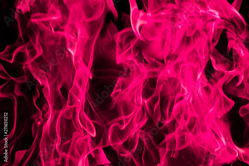 obraz lub plakat Blazing pink fire flame background and abstract