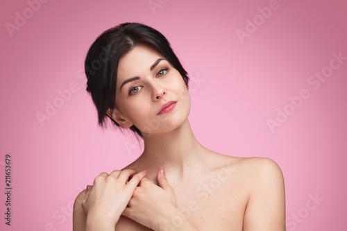 Obraz na plátně  Lovely woman touching shoulder