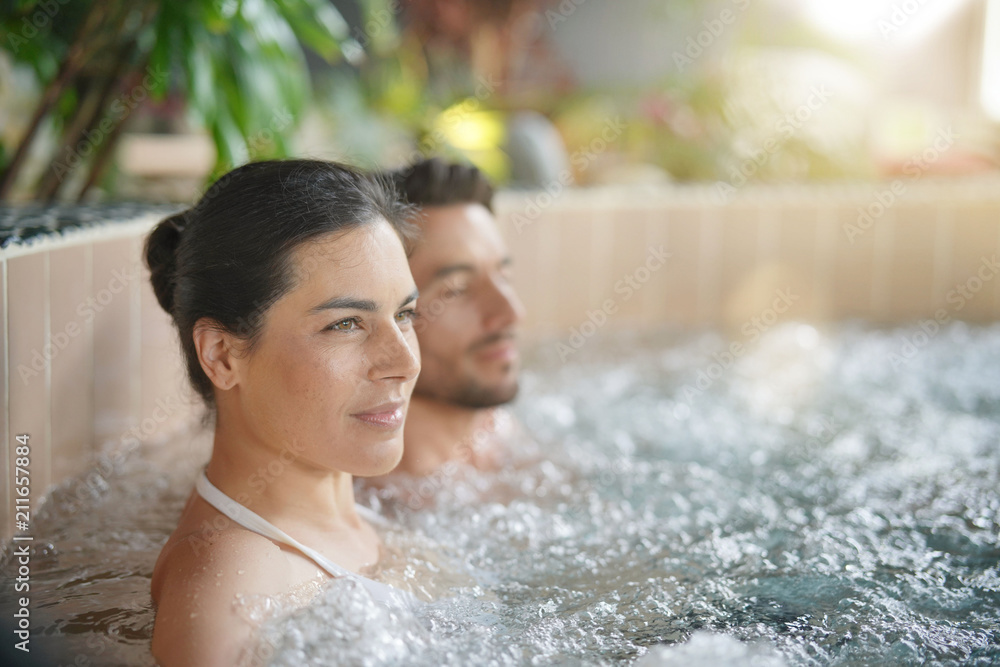 Fototapeta Couple relaxing in spa resort hot pool