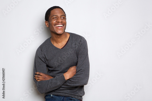 Vászonkép confident african american man smiling with arms crossed against white backgroun
