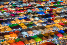 Aerial View,Bangkok Train Market Secondhand Market At Sunset Time. Bird Eyes View Of Multi-colored Tents /Sales Of Second-hand Market At Twilight - Panorama Picture  In Bangkok, Thailand