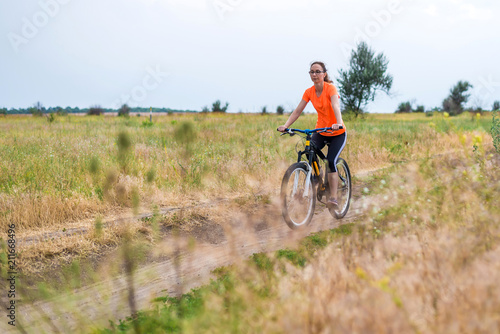 Staande foto Fiets Woman is riding a bicycle, an active lifestyle.