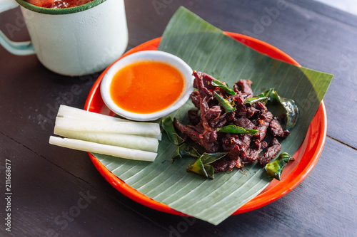 Neur Dad Diew (Thai Fried Sun-Dried Beef) with chili sauce served with iced passion fruit juice.
