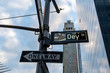 One way and street name sign