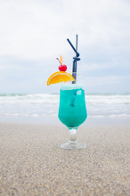 Blue Coctail In The Glass On The Sea Background