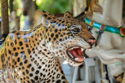 Deurstickers Luipaard carousel leopard is ready to give the next ride