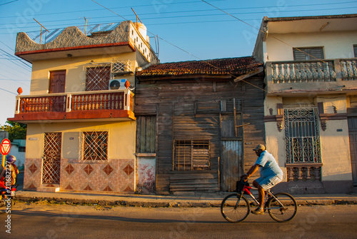 Tuinposter Mexico Cienfuegos, Cuba: View of the traditional local street in the Cuban city.