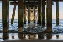 A View Of The Ocean From Beneath Jennette's Pier In Nag's Head Of The Outer Banks In North Carolina