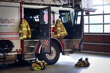 Firemen Gear On Firefighter Tr...