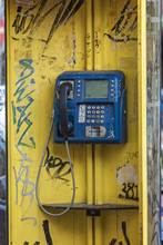 Old Yellow Phone Booth Sprayed With Graffiti In Thessaloniki, Greece, Unused For A Long Time