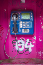 Old Magenta Phone Booth Sprayed With Graffiti In Thessaloniki, Greece, Unused For A Long Time