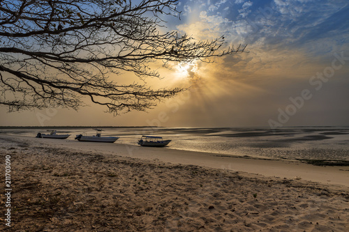 Foto auf Acrylglas Tropical strand View of a beautiful deserted beach in the island of Orango at sunset, in Guinea Bissau. Orango is part of the Bijagos Archipelago; Concept for travel in Africa and summer vacations