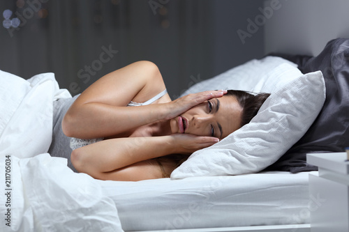 Valokuva  Desperate girl suffering insomnia trying to sleep