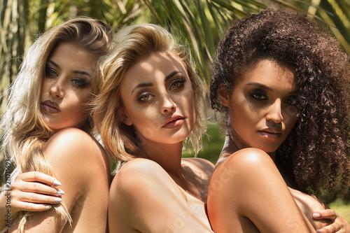 Three multiracial sensual girls posing. Wallpaper Mural