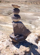 Balanced round stones on a mesa in the Bisti/De na zin wilderness In Northern NM.