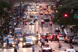 Fototapeta Nowy York - Busy evening cityscape with cars and people on 42nd Street in Midtown Manhattan New York City