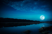 Night Sky And Bright Full Moon At Riverside. Serenity Nature Background.