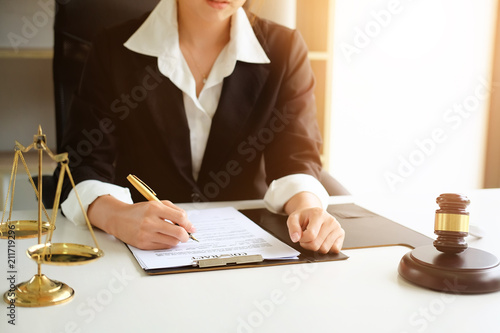 Judge gavel Justice lawyers, Business woman in suit or lawyer working on a documents Poster Mural XXL