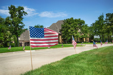 American Flags Displayed In Honor Of The 4th Of July In A Texas Neighborhood