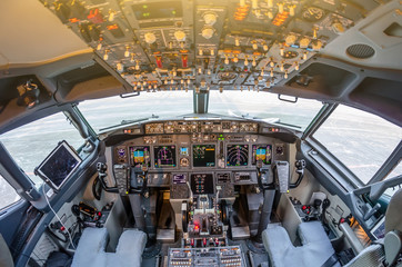 Passenger aircraft interior, engine power control and other aircraft control unit in the cockpit of modern civil passenger airplane.
