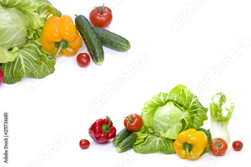 Printed kitchen splashbacks Fresh vegetables Green cabbage. Yellow pepper. Red tomatoes and cucumbers on a white background.