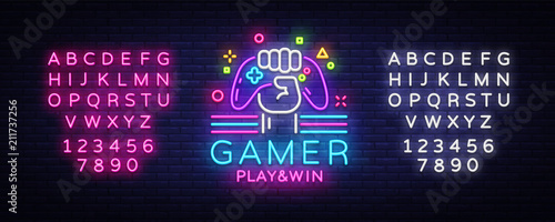 Fototapeta Gamer Play Win logo neon sign Vector logo design template. Game night logo in neon style, gamepad in hand, modern trend design, light banner, bright advertisement. Vector. Editing text neon sign obraz