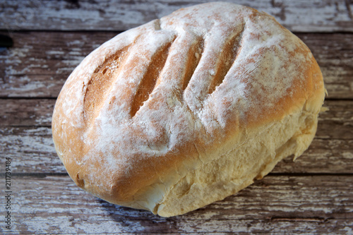 Foto op Aluminium Brood Loaf of bread on wooden board