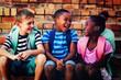 Leinwandbild Motiv Happy children sitting on steps